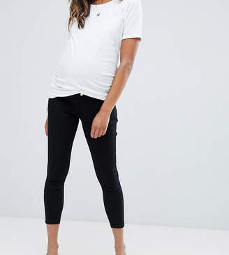 Asos DESIGN Maternity Petite Ridley skinny jeans in clean black with over the bump waistband