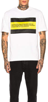Calvin Klein Est. 1978 Logo Graphic Tee in White & Black & Yellow | FWRD