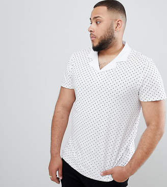 Asos DESIGN Plus polo with all over polka dot print and revere collar