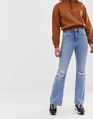 Asos Design DESIGN Rigid full length flare jeans with busted knee detail in mid stone wash