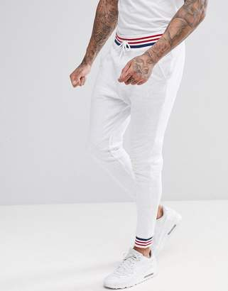 Asos Design Tapered Jogger With Tipping In White Marl