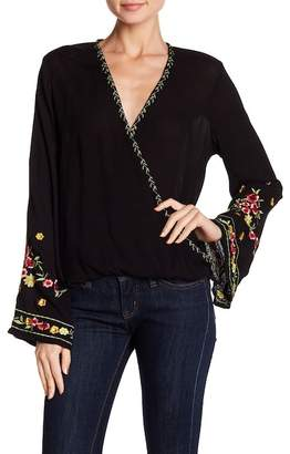 Love Stitch Embroidered Bell Sleeve Surplice Neck Blouse