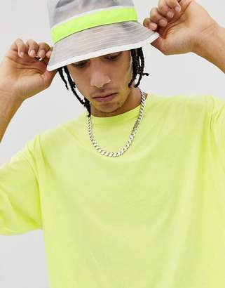 Asos DESIGN oversized t-shirt with half sleeve in washed neon yellow