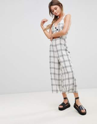 Asos DESIGN Jumpsuit in Textured Check with Wrap Front and Buttons