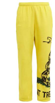 Vetements Snake Print Cotton Track Pants - Womens - Yellow