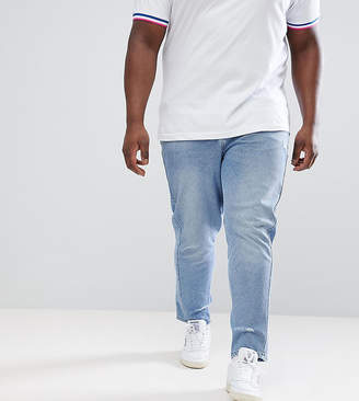 Asos DESIGN Plus Skinny Twisted Seam Jeans In Light Wash Blue With Abrasions