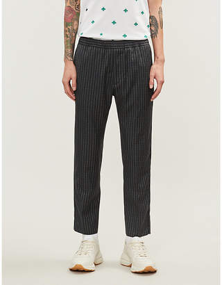 Gucci Logo-stripe tapered wool trousers