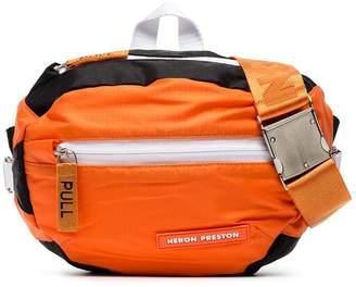 Heron Preston orange, black and white industrial strap messenger bag