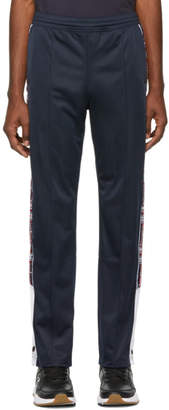 Champion Reverse Weave Navy Jacquard Logo Tape Popper Track Pants