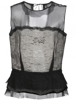 Maison Margiela sheer peplum blouse $1,190 thestylecure.com
