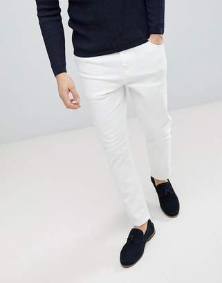 Asos DESIGN Tapered jeans in white
