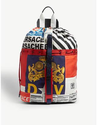 Versace News print canvas duffle bag 5f605b0bb5ba9