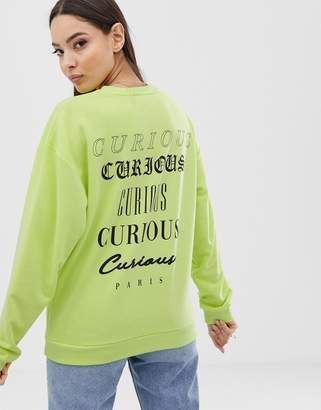 Asos Design DESIGN sweatshirt in washed neon with slogan print