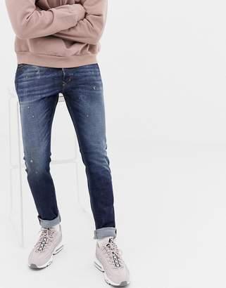 Diesel Tepphar slim carrot fit jeans in 087AT dark wash