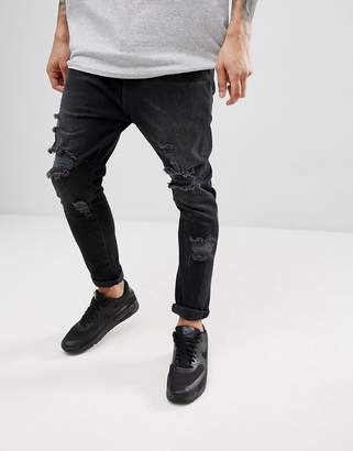 Asos Design DESIGN Drop Crotch Jeans In Washed Black With Heavy Rips