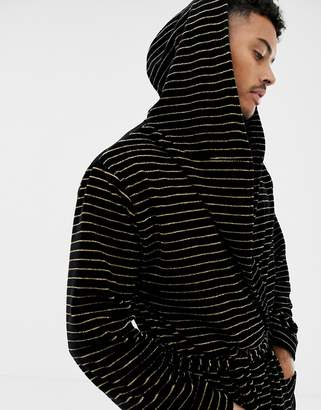 Asos Design DESIGN hooded dressing gown in black with gold stripes