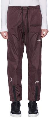 A-Cold-Wall* Logo print zip cuff jogging pants