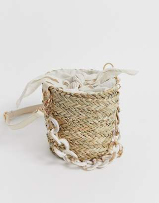 South Beach straw bucket bag with resin link handle and linen tie