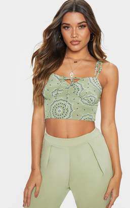 bb81ea0730fac0 PrettyLittleThing Sage Green Floral Printed Cup Tie Detail Sleeveless Crop  Top