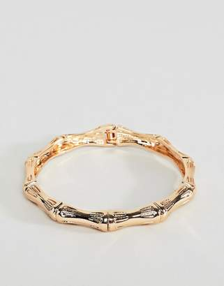 Asos DESIGN bangle bracelet with chunky textured vintage detail in gold