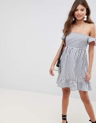 Asos DESIGN off the shoulder mini sundress with pep hem in stripe