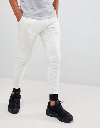 Asos Design DESIGN super skinny joggers in white nep with contast cuff and waistband