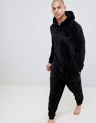 Asos DESIGN hooded onesie in fluffy black fabric
