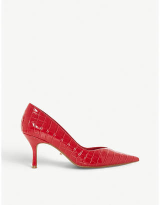 Dune Andersonn crocodile-embossed patent courts