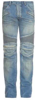 BALMAIN Light-wash distressed slim-leg jeans $1,452 thestylecure.com