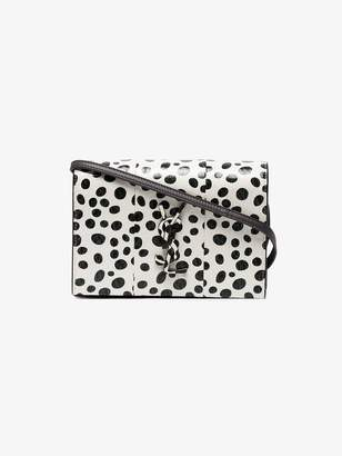Saint Laurent black and white Kate polka dot leather wallet on a chain