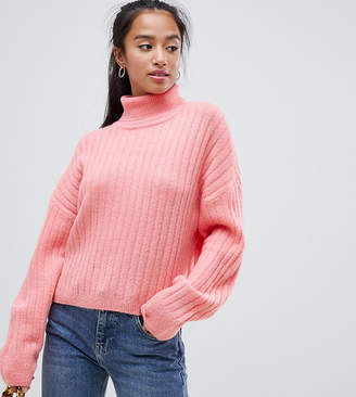 Asos DESIGN Petite fluffy sweater in rib with roll neck