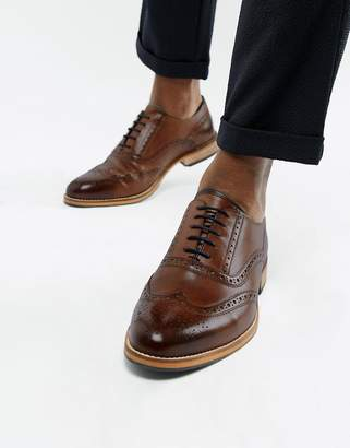 Asos Design DESIGN brogue shoes in brown leather with natural sole and colour details