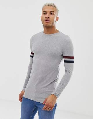 8b5cf046 Asos Design DESIGN muscle fit longline long sleeve t-shirt with stretch and  contrast sleeve