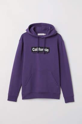 H&M Hooded Sweatshirt with Motif - Purple