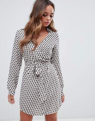 PrettyLittleThing wrap tie waist shirt dress in geo print