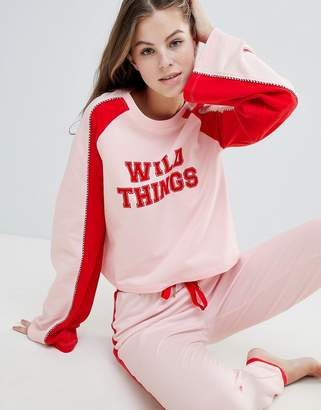 Asos DESIGN Lounge Wild Things Long Sleeve Sweat