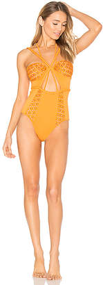 For Love & Lemons Samba Braided One Piece in Orange $202 thestylecure.com