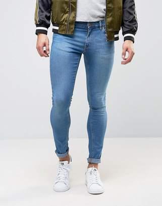 Asos DESIGN extreme super skinny jeans in mid blue