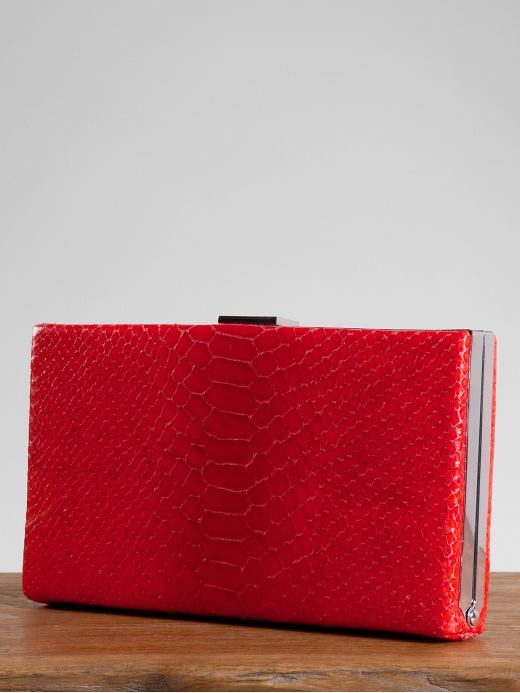 Bright snake-embossed clutch