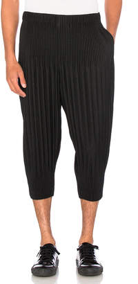 Issey Miyake Homme Plisse Pleated Cropped Trousers in Black | FWRD