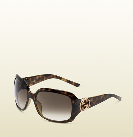 Gucci medium rectangle frame sunglasses with GG detail on temple.