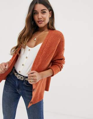 Asos Design DESIGN chunky cardigan in moving rib with statement button