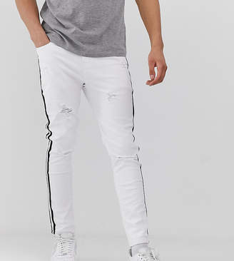 Mauvais muscle jeans with distressing and side stripe