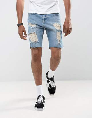 Asos DESIGN Denim Shorts In Slim Mid Wash Vintage Blue With Heavy Rips