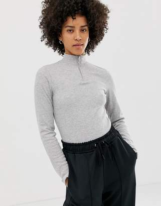 Asos DESIGN fitted top in rib with long sleeve and zip through collar