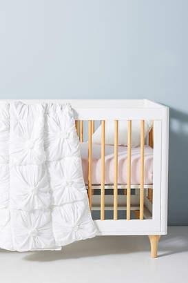 Anthropologie Organic Rosette Toddler Quilt
