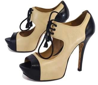 L.A.M.B. Cream & Black Leather Peep Toe Heels $98.99 thestylecure.com