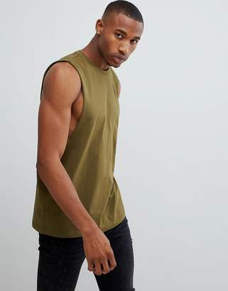 Asos DESIGN relaxed fit tank with dropped armhole in green