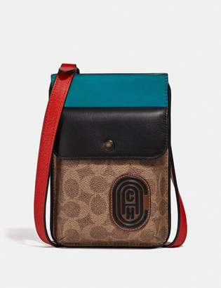 Coach Hybrid Pouch With Signature Canvas Blocking And Patch