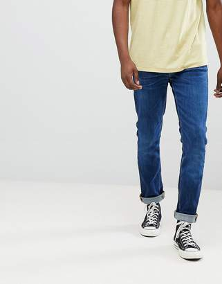 Nudie Jeans Lean Dean tapered organic cotton jeans in blue tilt